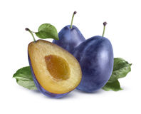 Two plums and split  on white background Stock Photo