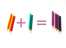 Two plus three - well, five! colored pencils. On a white background. Isolated Royalty Free Stock Photos