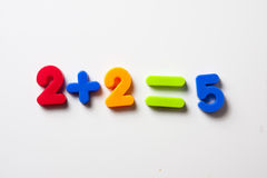 Two plus two equals five. Childs magnetic numbers set up in an incorrect sum Stock Images