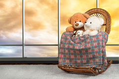 Two plush stuffed bear swinging on the wicker rocking chair. Two bear swinging on the wicker rocking chair royalty free stock images