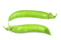 Two pods of green peas isolated on white Stock Photography