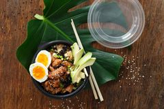 Two poke bowl fried rice chicken meat eggs box top view Asian take away food royalty free stock image