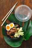Two poke bowl fried rice chicken meat eggs box top view Asian take away food stock images