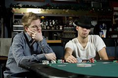Two poker players with poker faces Royalty Free Stock Photos