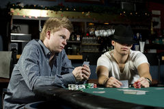 Two poker players with poker faces Royalty Free Stock Images
