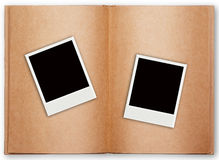 Two polaroid frame with old book open Royalty Free Stock Image