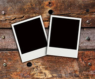 Two polaroid photo on wood background Stock Images