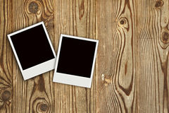 Two Polaroid photo frames on woo Stock Photo