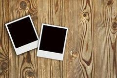 Two Polaroid photo frames on woo. Two polaroid with Wooden Board Texture photo Stock Photo