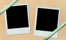 Two polaroids on bulletin board with ribbon Stock Photo