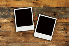 Two polaroids old grunge wooden wall texture Royalty Free Stock Images