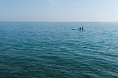 Two poles in the sea Stock Photos
