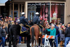 Two police on horses, keeping crowds in check during Chowderfest,Saratoga Springs,New York,2016 Royalty Free Stock Photos