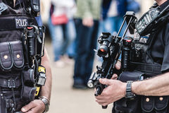 Two Police Officer with Machine-Gun in London. Close up horizontal photography Stock Photos