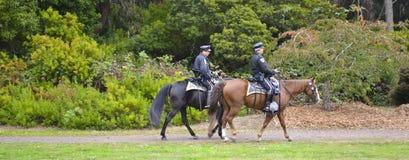 Two police officer in the park. Police man on horseback patrolling Golden Gate Park in San Francisco Stock Image