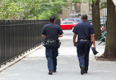 Two police officers from the back in the center of Manhattan. Stock Image