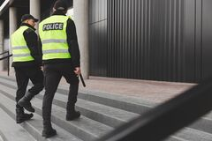Free Two Police Officers In Reflective Vests Patrol The Streets Of The City Royalty Free Stock Photo - 174228815