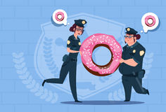 Two Police Women Holding Donut Wearing Uniform Female Guards On Blue Bricks Background Royalty Free Stock Photography
