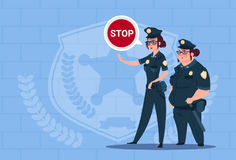 Two Police Women Holding Stop Sign Wearing Uniform Female Guards On Blue Bricks Background Stock Images