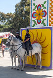 Two policeman with horse. At the fair in Rota in Cadiz Spain, seen some people walking. is an editorial image vertical on a sunny day Royalty Free Stock Image