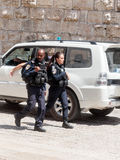 Two policemen patrol the streets in the old city of Jerusalem, Israel. royalty free stock photography