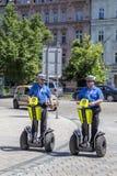 Two policemen patrols on a Segway Stock Photo