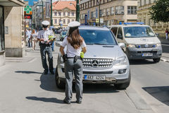 Two policemen prescribed fee for parking on the street Royalty Free Stock Image