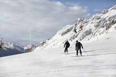 Two policemen on skis. Police in a ski resort. Rescuers in the mountains. the policeman descends on skis. Valbona, Lusia, Bellamon stock photo
