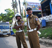 Two policemen standing on street Royalty Free Stock Photos