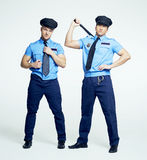 Two policemen, striptease Royalty Free Stock Images