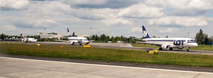 Airliners waiting for take off on taxiway on Chopin Airport in Warsaw in Poland. Royalty Free Stock Photography