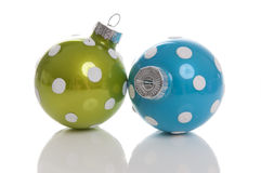 Two polka dots Christmas balls. Isolated on a white background stock photography