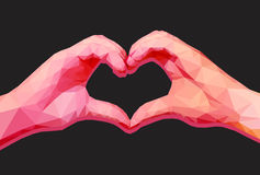 Two polygonal hands in form of a heart with red shades on a blac Stock Images
