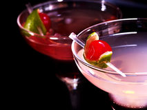 Two pomegranate cocktail glass with cherry Royalty Free Stock Photos