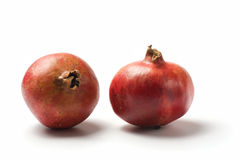 Two pomegranate fruits isolated Stock Image