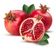 Two pomegranate and one cut in half with leaf royalty free stock images