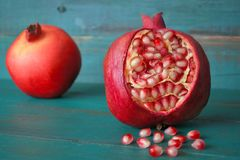 Two PomegranateFruit and seeds. Two Pomegranate Fruit and seeds. Food background and texture for the Jewish festival of Sukkot Feast of Tabernacles in Israel and Stock Photos