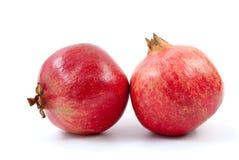 Two pomegranates. On the white background Stock Image