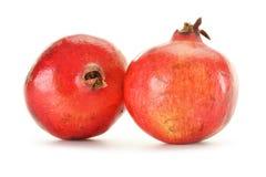 Two pomegranates isolated on white Stock Photos