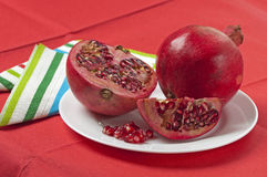 Two pomegranates on a plate Stock Image