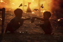 Poor children from India. Two poor and dirty children from the Indian city of Pushkaror Pushkar Mela play on the dusty street.Pushkar Mela, is a colorful and Stock Images