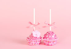 Two pop cake with pink glaze and decor Stock Photography