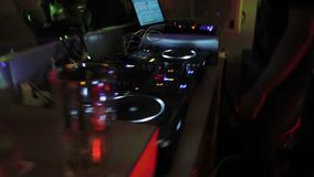 Two popular deejays playing music at mixing console in the nightclub. Party. Stock footage stock video footage