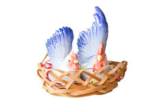 Two Porcelain Chicken In Wooden Basket. Royalty Free Stock Photo
