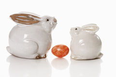 Two porcelain Easter bunnies with egg Stock Photos