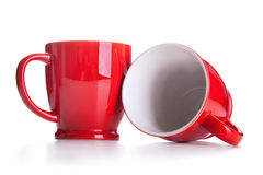Two porcelain red mugs Stock Photography