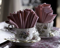 Two Porcelain Tea Cups with Pink Napkins Royalty Free Stock Photography