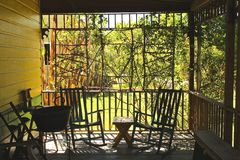 Two porch chairs. Two rocking chair sits amongst on a southern creole veranda in Louisiana royalty free stock photo