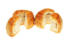 Two pork pies. Two cut pork pies isolated against white Stock Photos