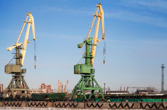 Two port cranes with cargo train Royalty Free Stock Photo